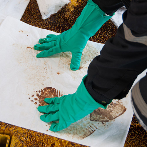 Absorbent pads cleaning a spill
