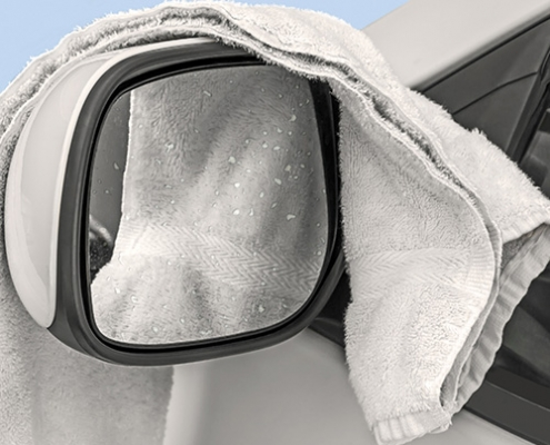 Terry cloth draped over car's sideview mirror