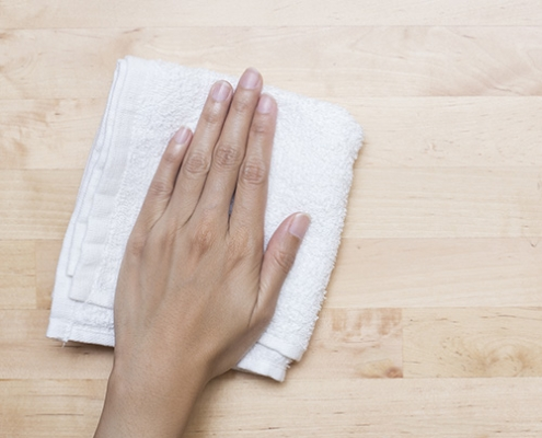 Hand with terry cloth, wiping surface