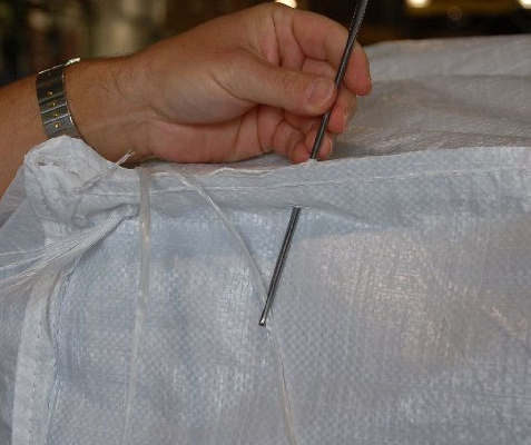 needle sewing a capsack closed